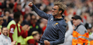 Jurgen Klopp took a sly dig at Manchester City coach Pep Guardiola over the phone