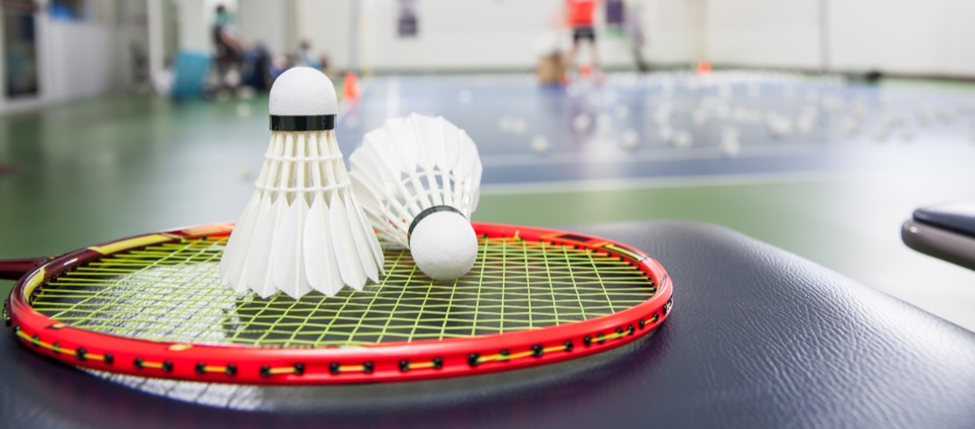 Parent watches as Aguda daughters battle each other in badminton competition final